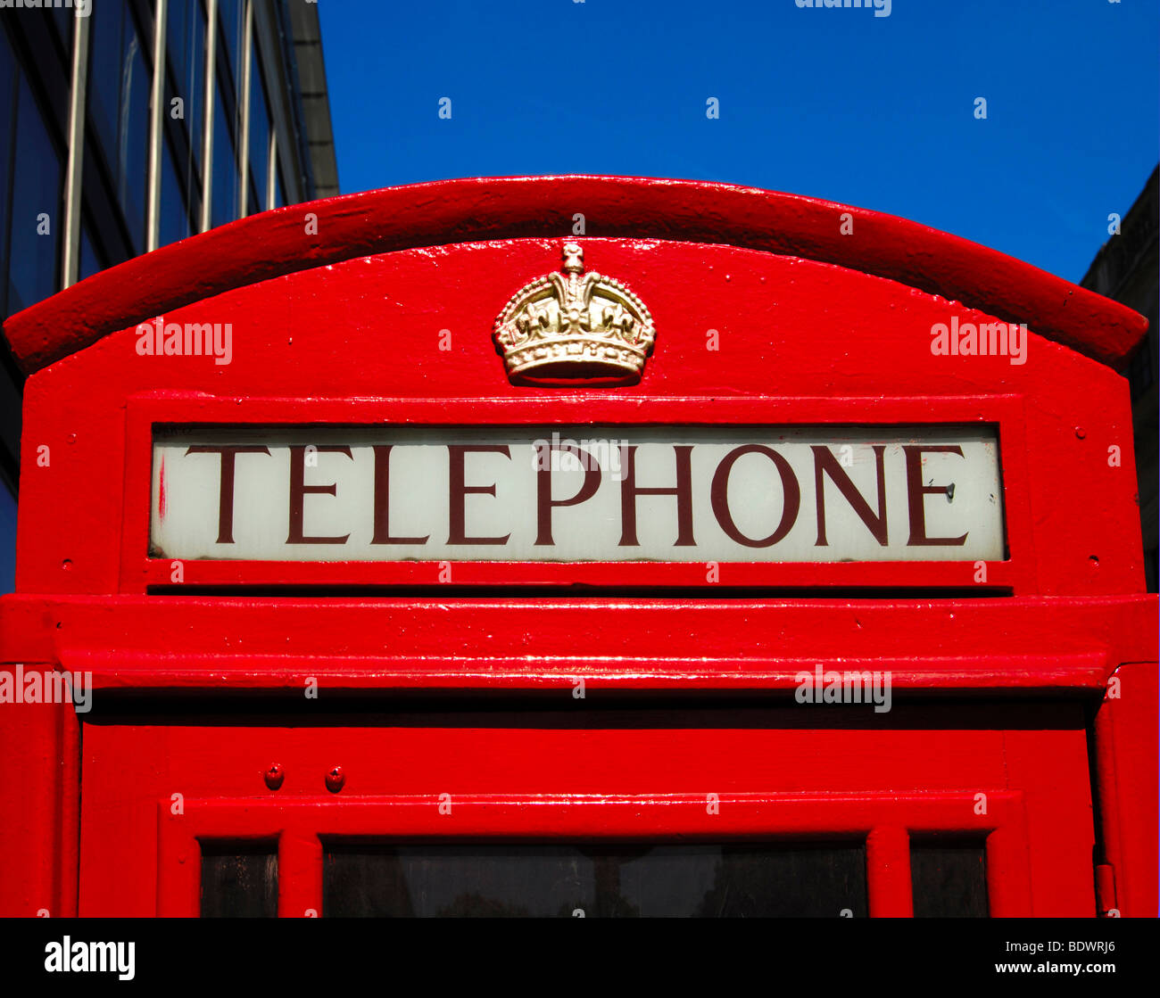Tradional red telephone box with the St Edward's Crown in the city centre of London, United Kingdom, Europe - Stock Image