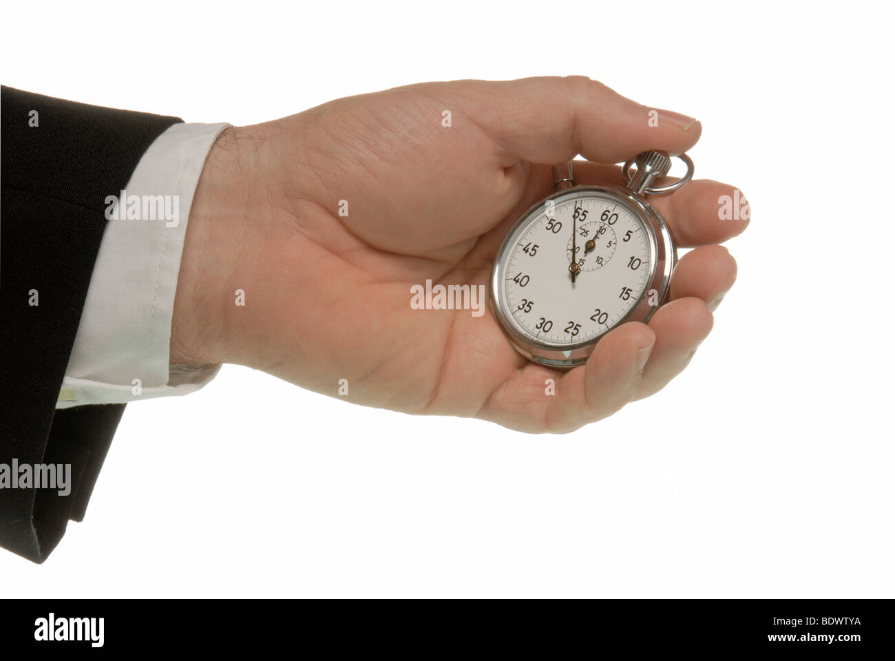 Business man with a stopwatch, a symbolic image for time pressure - Stock Image