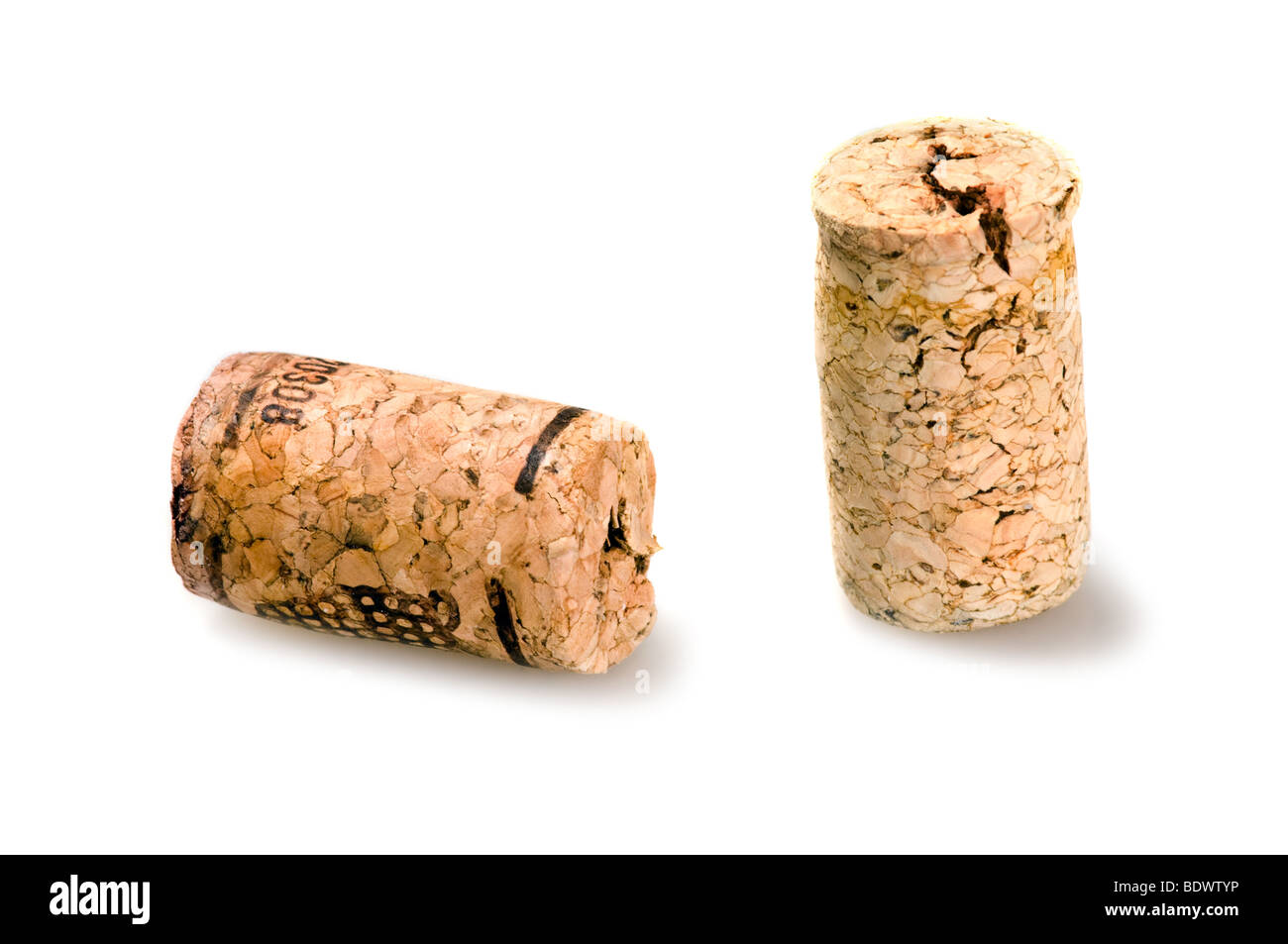 Two corks from wine bottles on white background - Stock Image