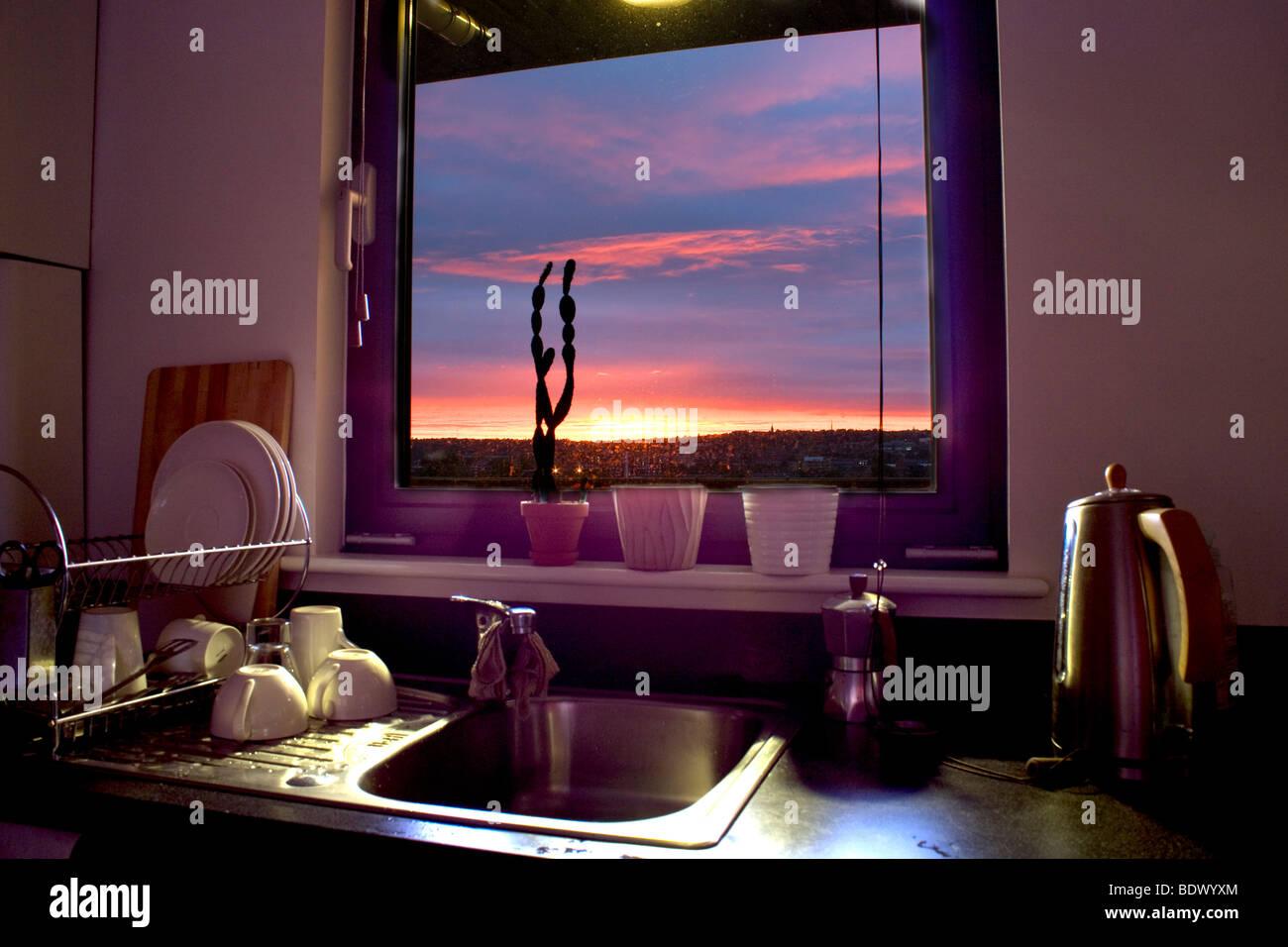 HDR sunset seen through a kitchen window Stock Photo