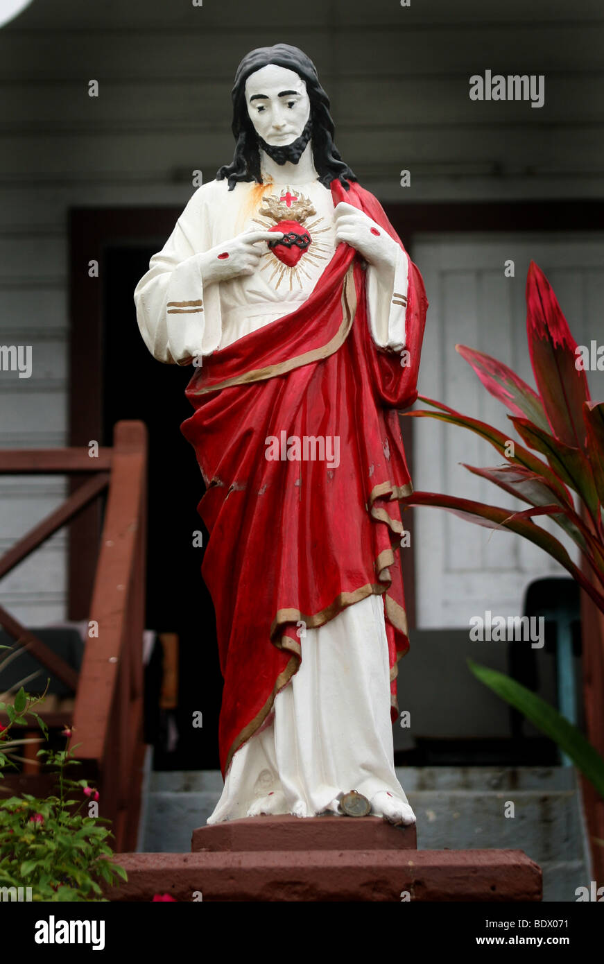 A statue of Christ reflects the Spanish origins of Tongan Christianity in Vavau Tonga. - Stock Image