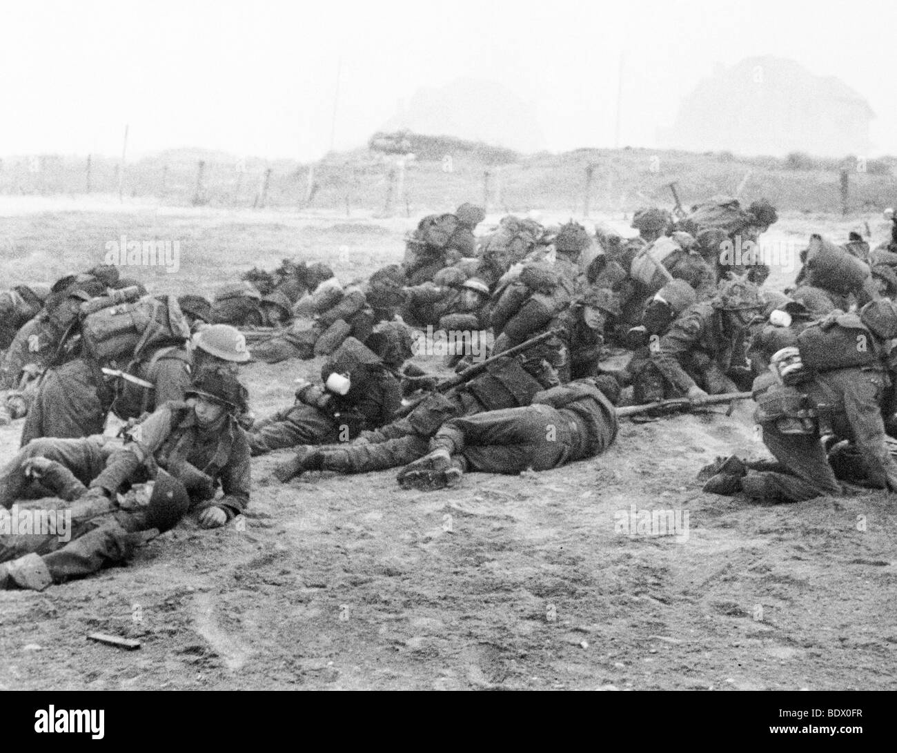 6 JUNE 1944 - British troops of the Suffolk Regiment under heavy fire at Coleville end of SWORD beach  - see Description - Stock Image