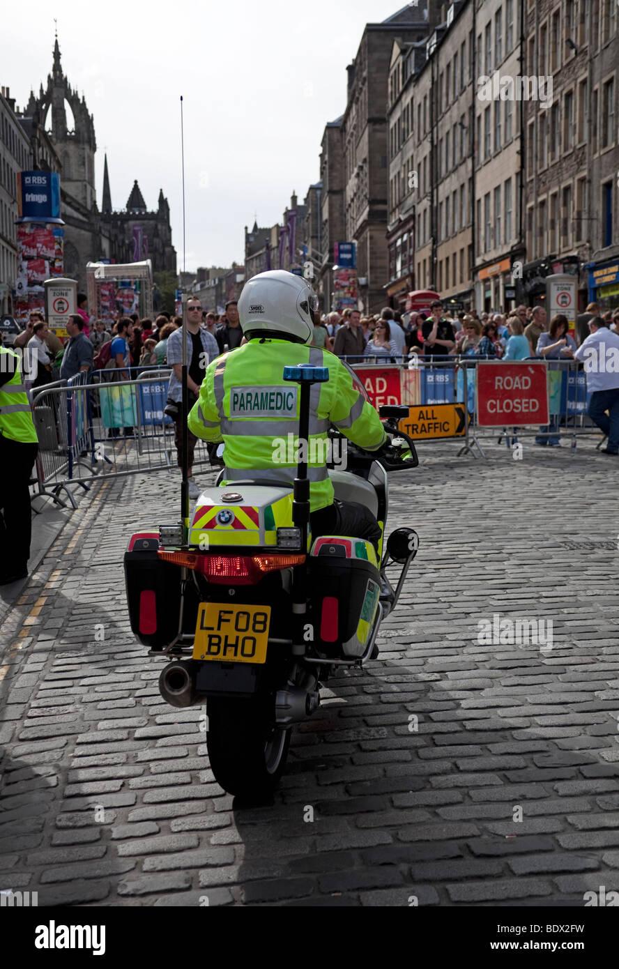 Paramedic on motorcycle, Royal Mile Edinburgh, Scotland - Stock Image