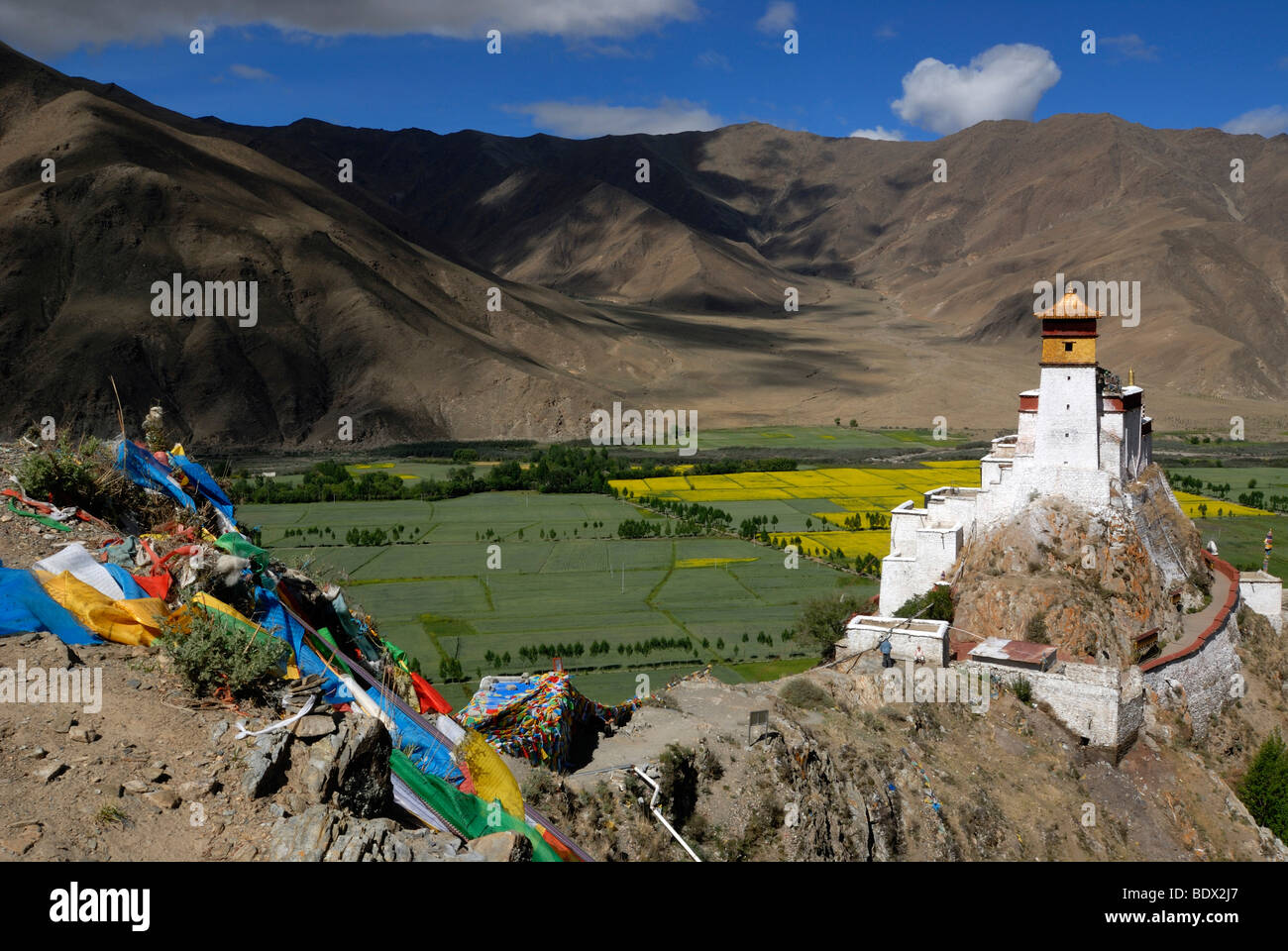 First and oldest fortress of Tibet, Yumbulagang with prayer flags above the Yarlung valley, Central Tibet, Tibet, - Stock Image