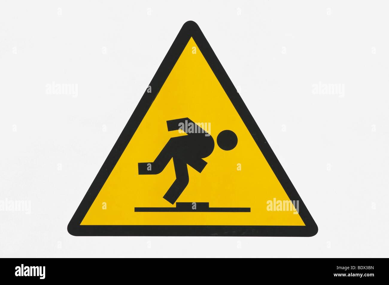 Warning sign, danger of stumbling Stock Photo