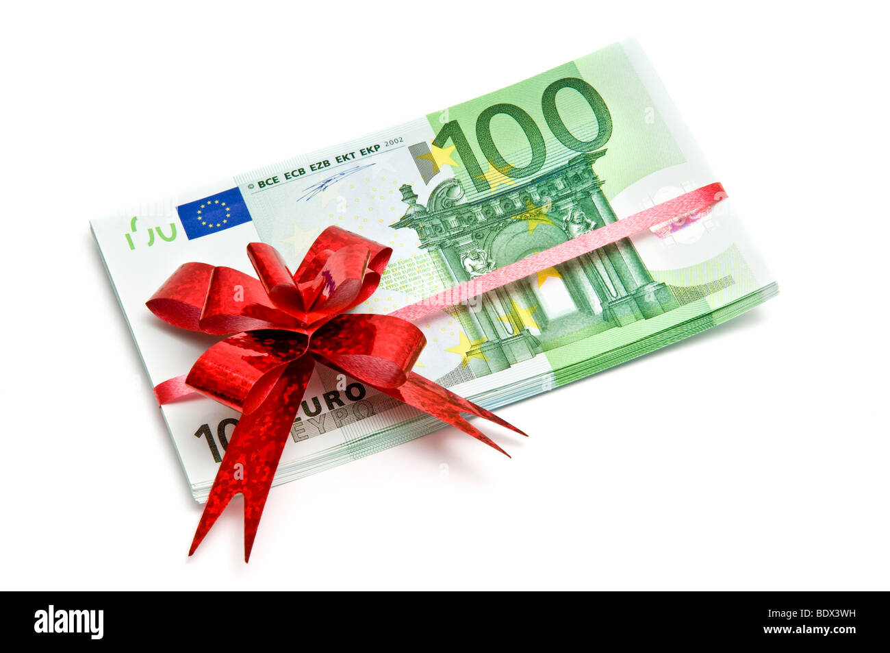 Banknotes tied red ribbon isolated on white - Stock Image