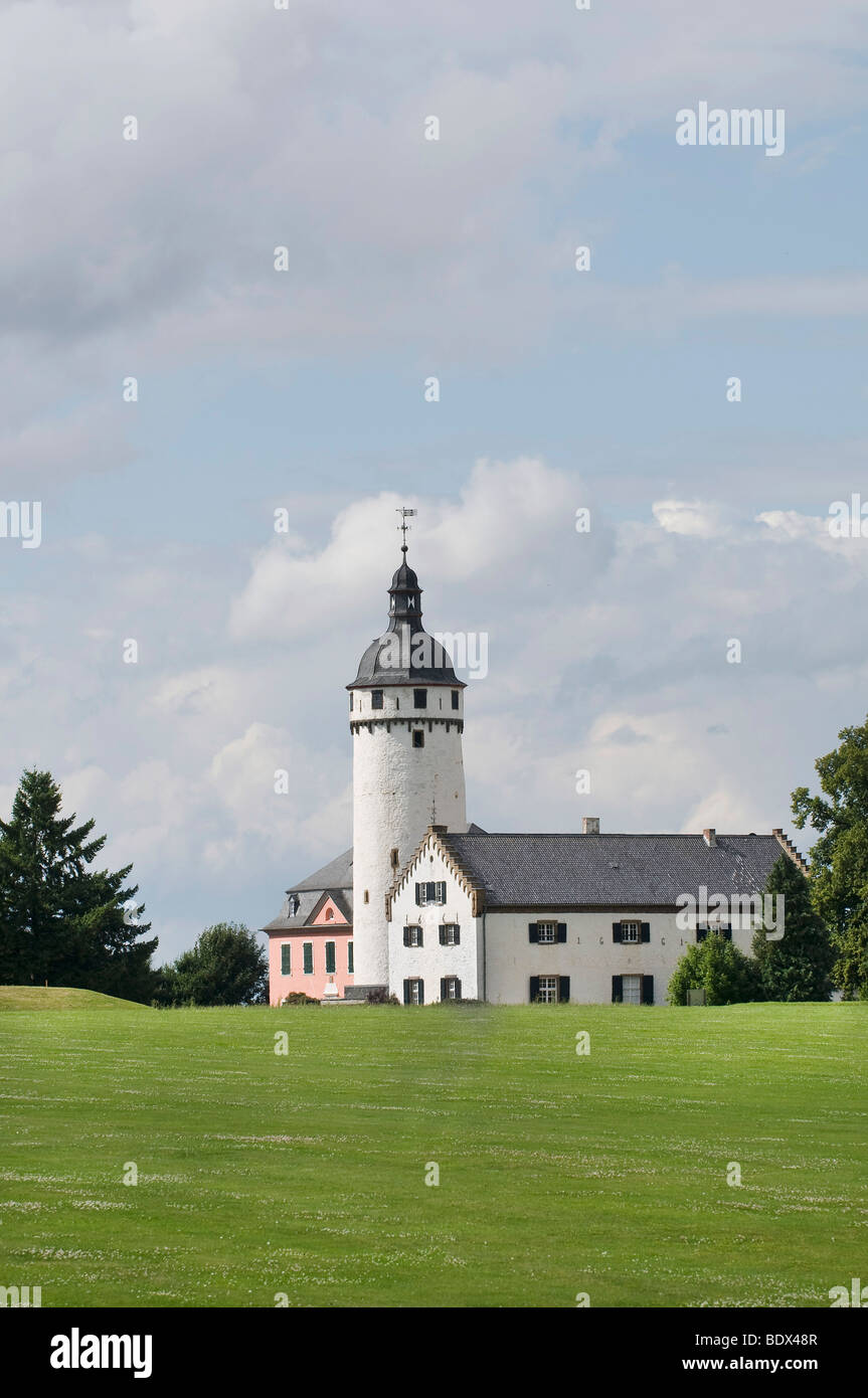 Golf course Burg Zievel castle, new mansion, keep and building from 1661, in the front golf turf, Mechernich, Rhineland Stock Photo