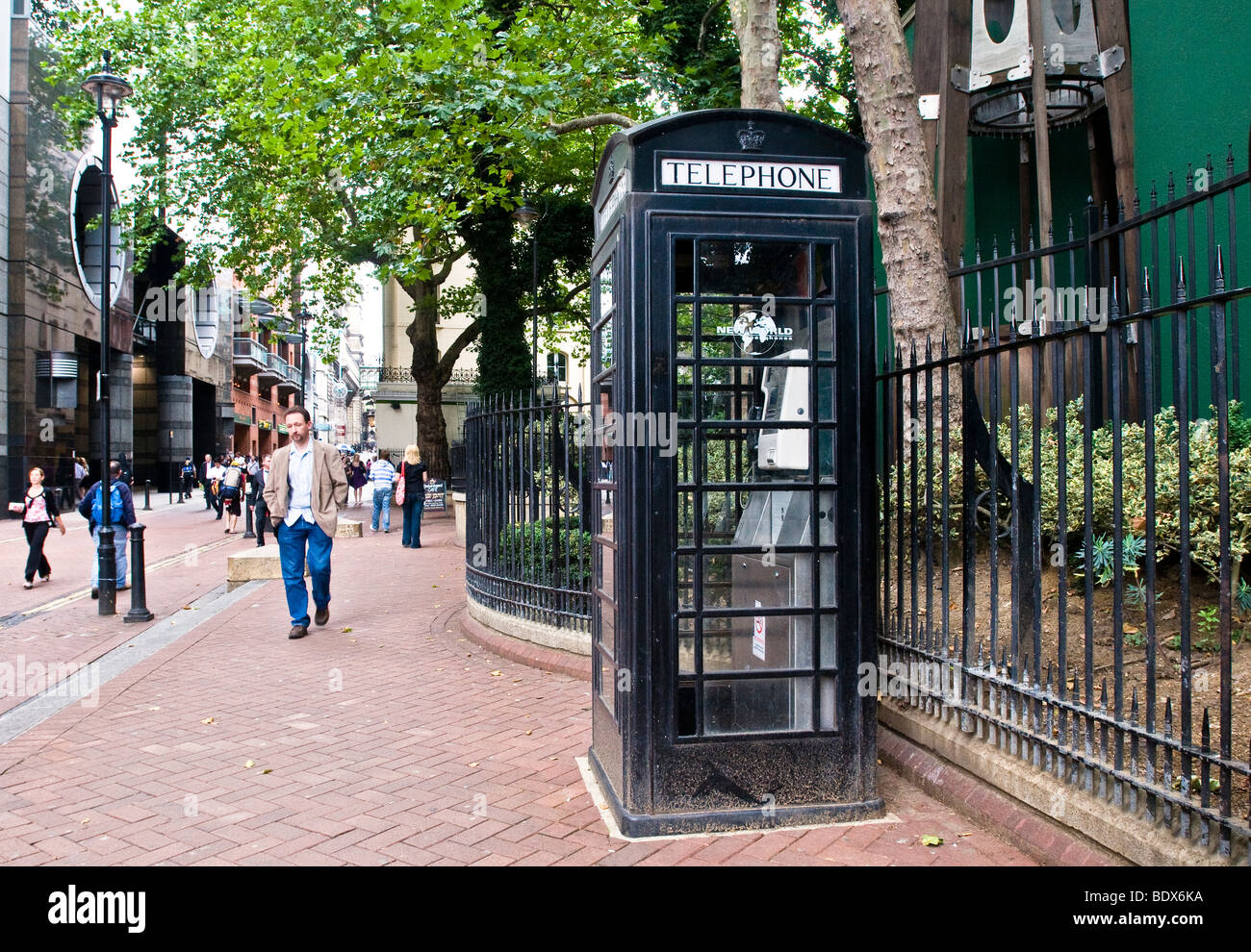 A black telephone box in the City Of Westminster London - Stock Image