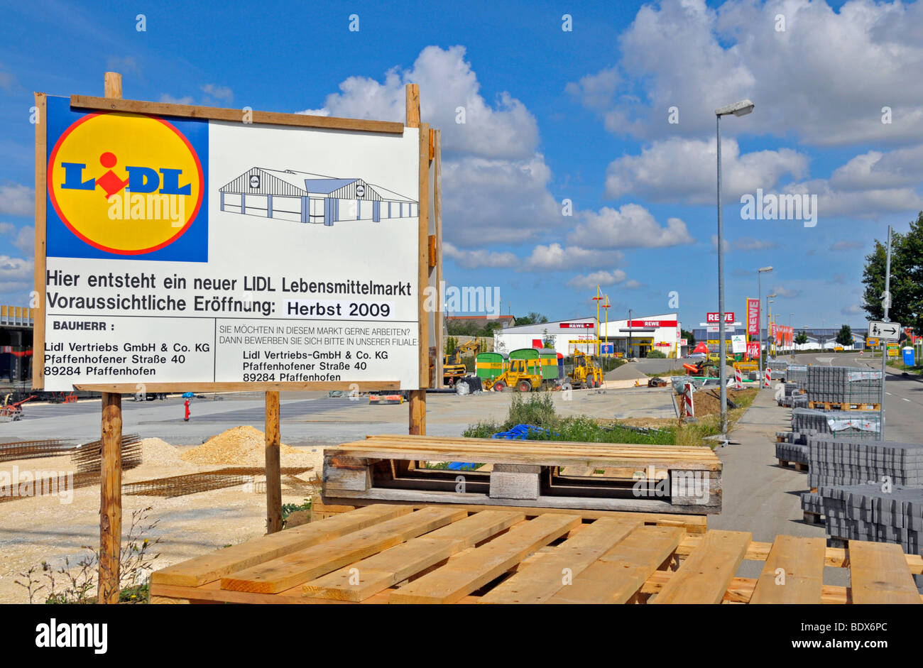 Construction site and announcement of the opening of a Lidl food market, in the back a Rewe food store, Dornstadt, - Stock Image