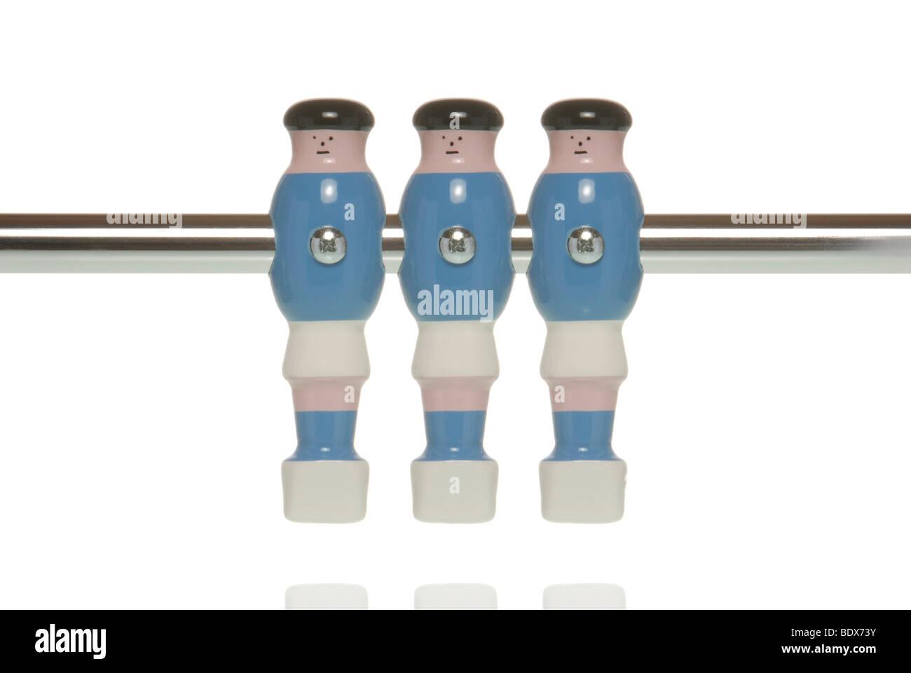Three tabletop football figures, foosball, tabletop soccer - Stock Image