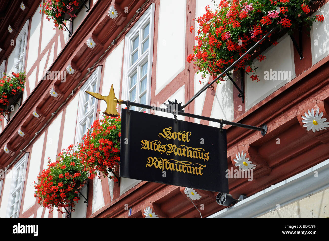 Hotel sign on the half-timbered historic Town Hall, Wolfhagen, Habichtswald National Park, Hesse, Germany, Europe - Stock Image