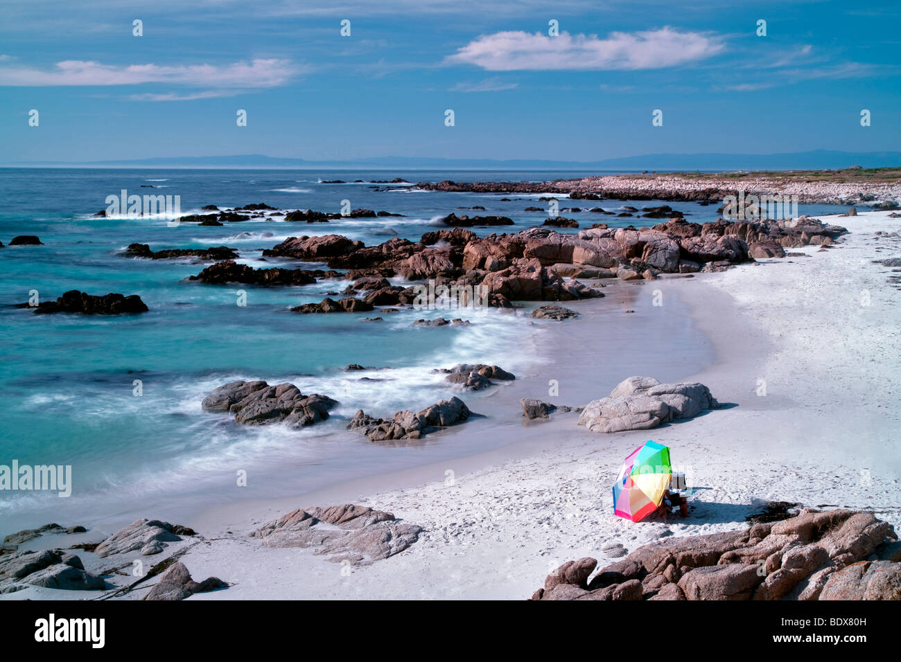 Beach umbrella and beach. 17 Mile Drive, Pebble Beach, California 17 Mile Drive, Pebble Beach, California - Stock Image