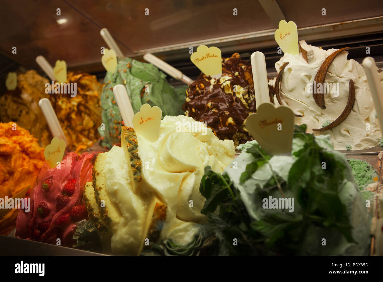 Italian Gelataria ice cream shop (multiple colourful assorted flavours) in window display, Florence, Tuscany, Italy, - Stock Image