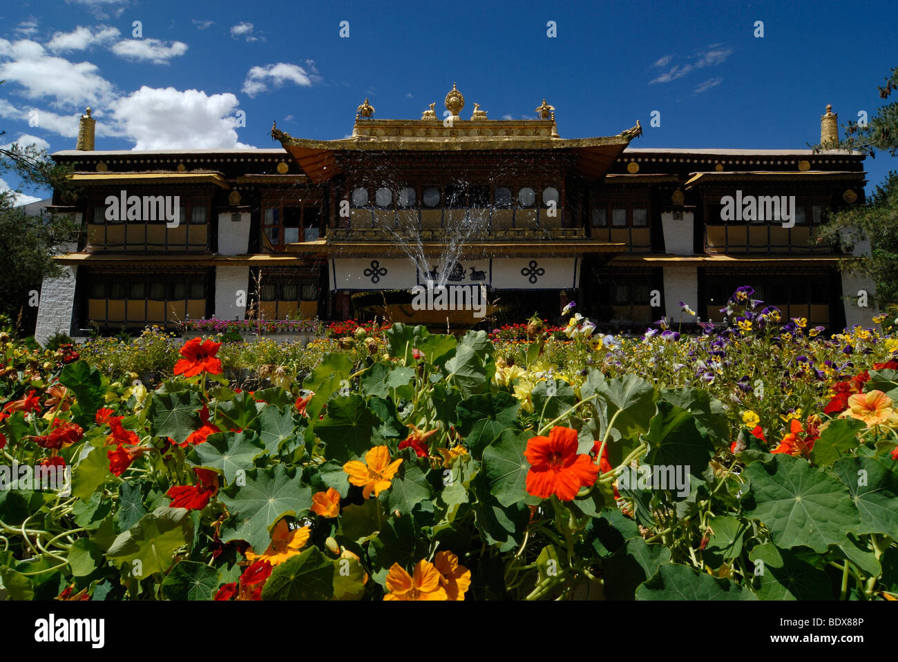 Summer palace of the Dalai Llama in Norbulingka, jewel garden with flowers and water fountain, Lhasa, Tibet, China, - Stock Image