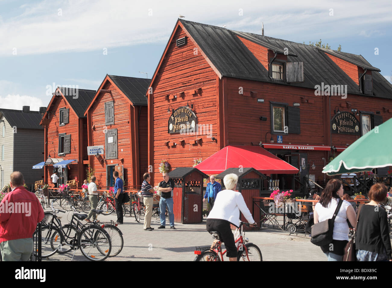 Old granaries in Oulu Finland nowdays used as cafés and boutiques - Stock Image
