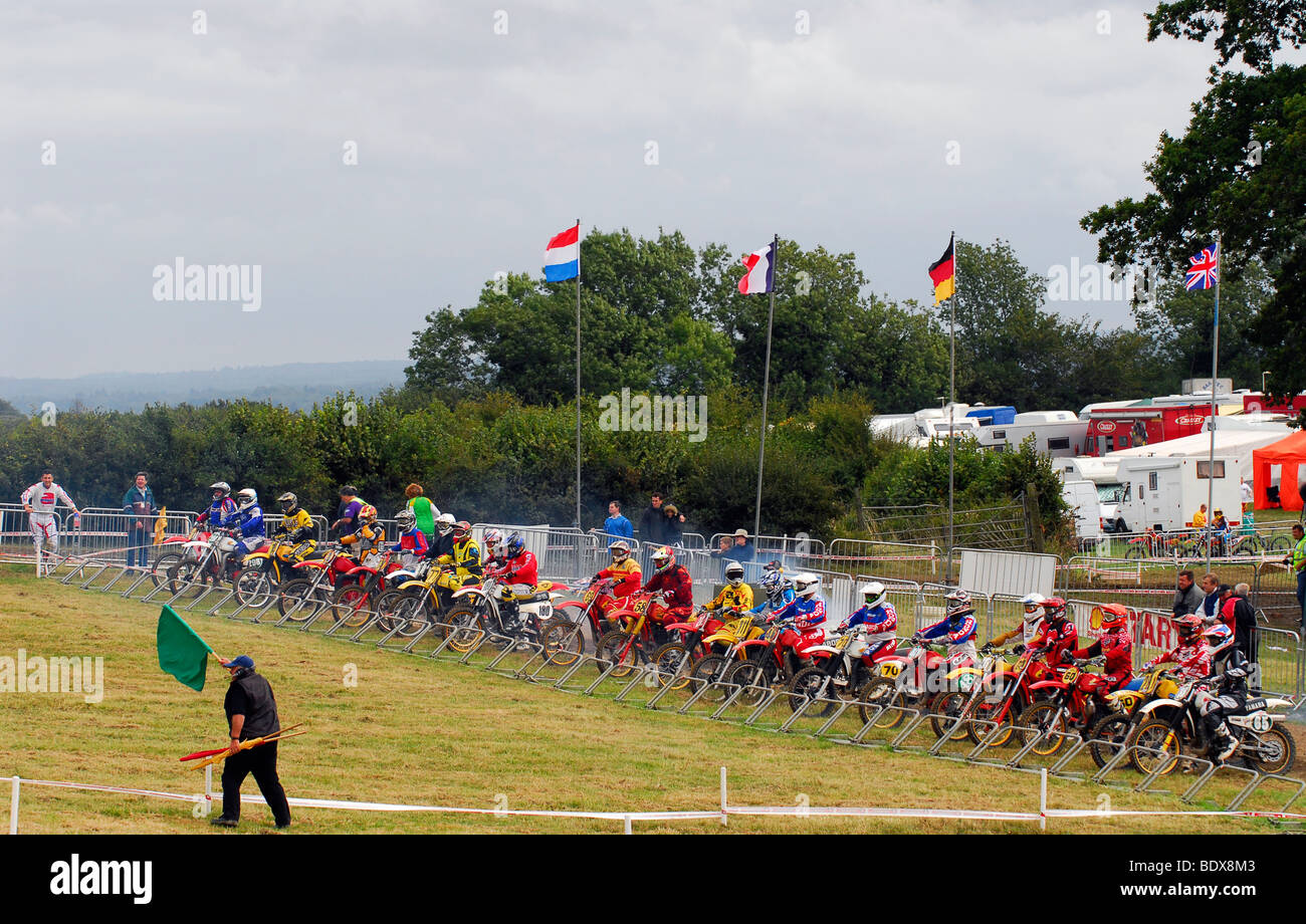 Riders at start of motocross race competing for the Ken Hall Trophy, Manor Farm, Langrish, near Petersfield, Hampshire - Stock Image