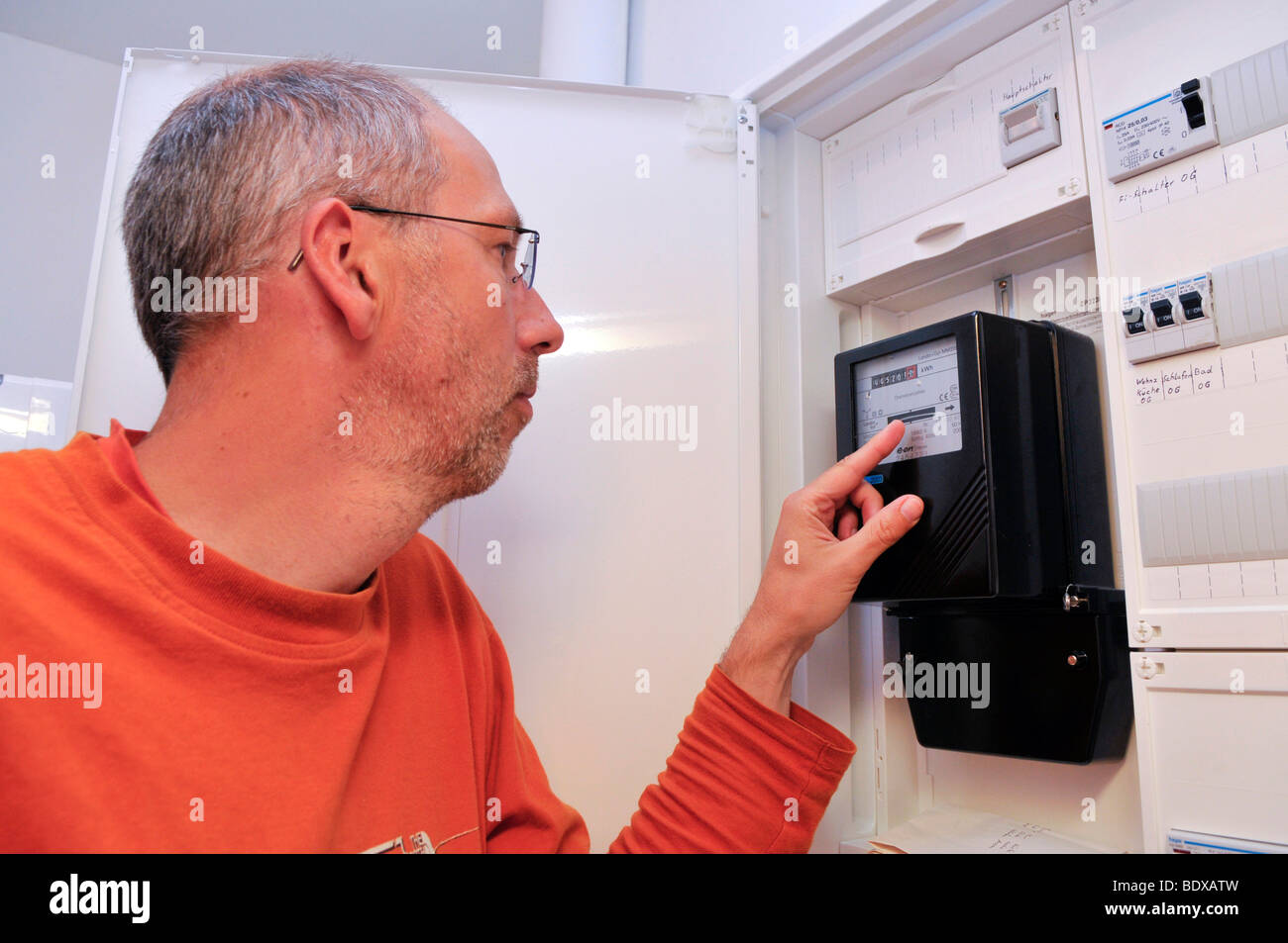 Man reading electricity meter - Stock Image
