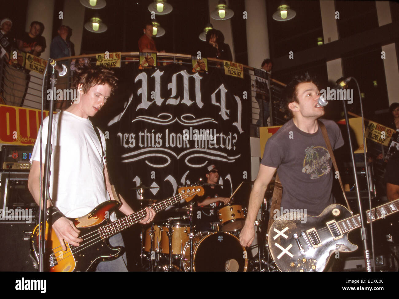 SUM 41  - Canadian punk group in November 2002 with Deryck Whibley at right - Stock Image