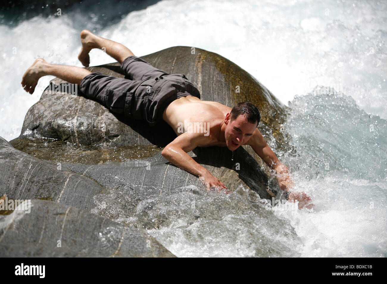 Tourist having fun and cooling off in summer at the rapids of the river Maggia, Ticino, Switzerland, Europe Stock Photo