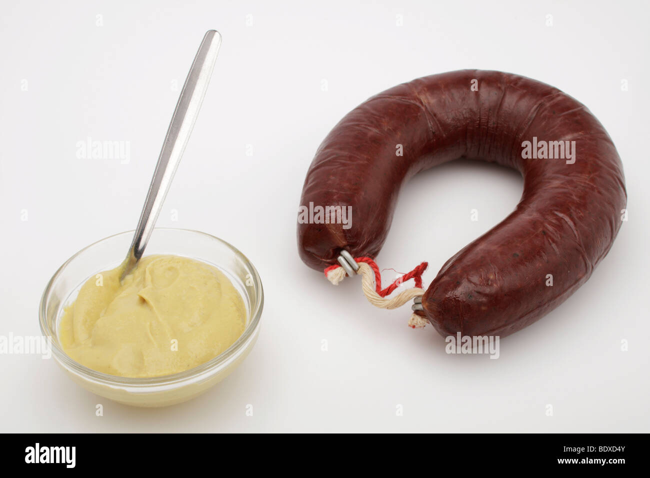 Ring of black pudding with mustard - Stock Image