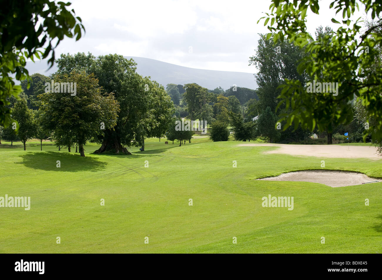 Golf course and mountains in a summer time - Stock Image
