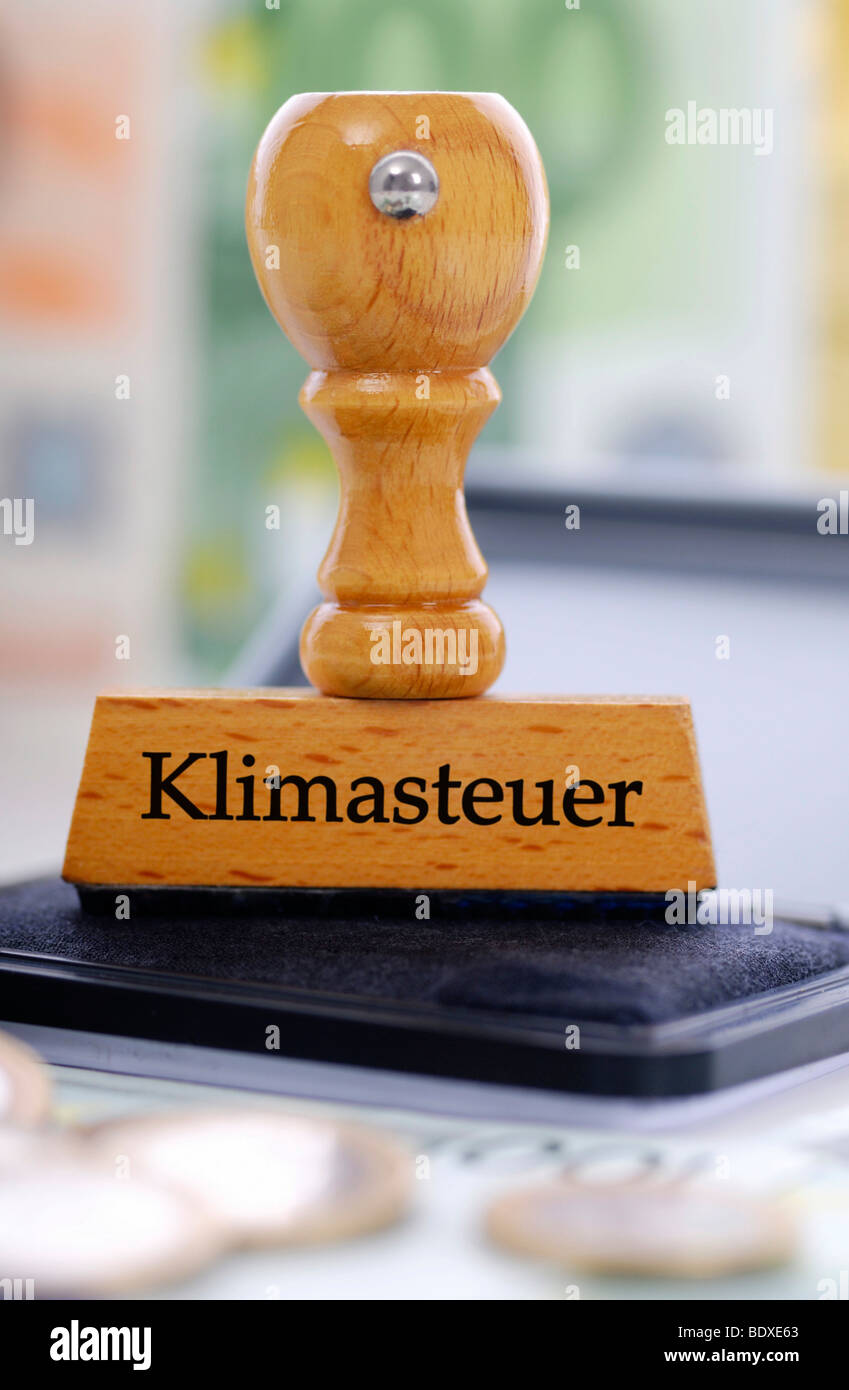 Stamp labelled 'Klimasteuer', German for 'climate tax' - Stock Image