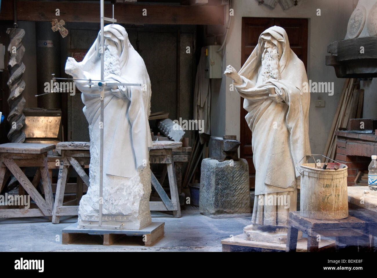 A statue of a saint being copied in the original studio della opera of the Duomo cathedral Florence - Stock Image