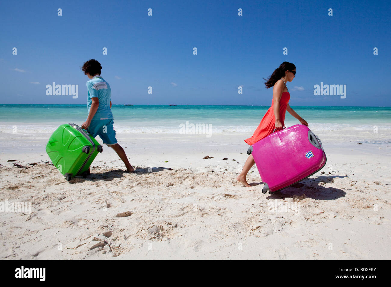 Two teenagers parting ways on holiday - Stock Image
