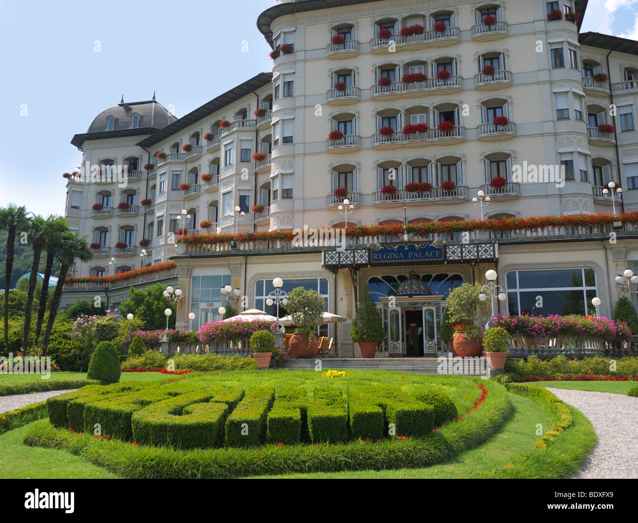 The Entrance Of The Grand Hotel Regina Palace One Of The Lake Front Stock Photo Alamy
