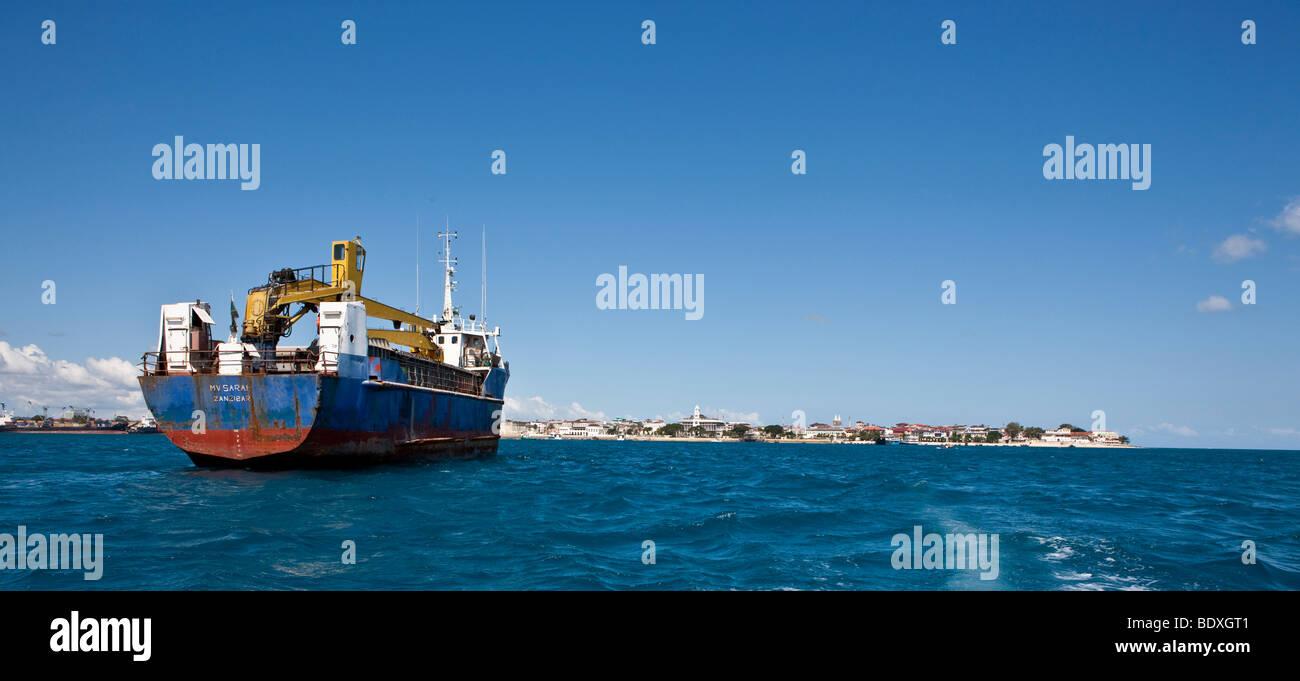 A cargo ship on its way to the port of Stonetown, Stonetown Zansibar, Zanzibar, Tanzania, Africa - Stock Image