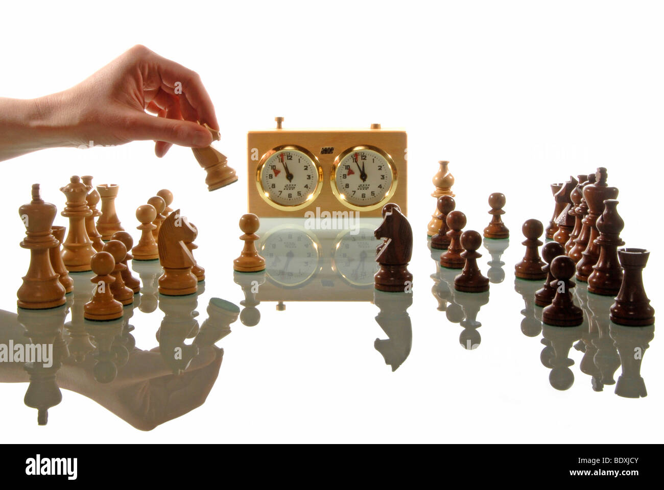 Female hand is playing chess, symbolic image for strategy - Stock Image