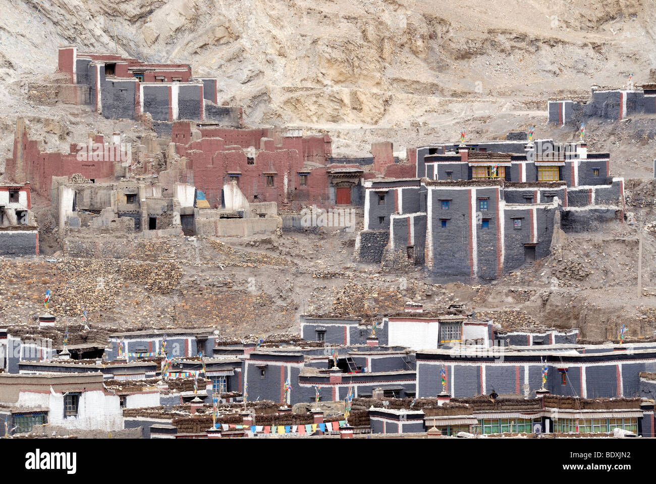Tibetan temple and monastery complex in Sakya architectural style and paint on the mountain slope, Sakya, Central - Stock Image