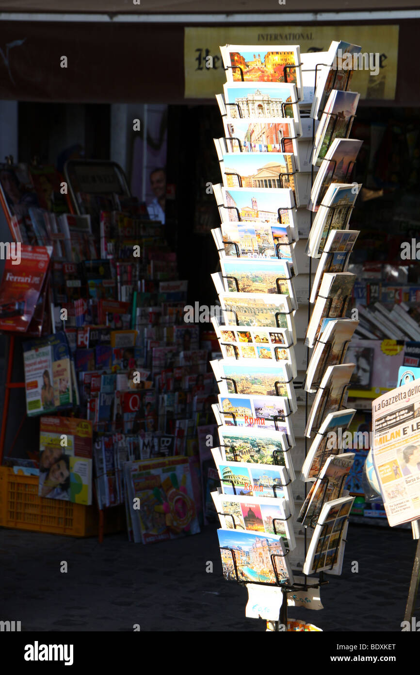 Postcard rack at a newspaper kiosk in Rome, Italy. Stock Photo