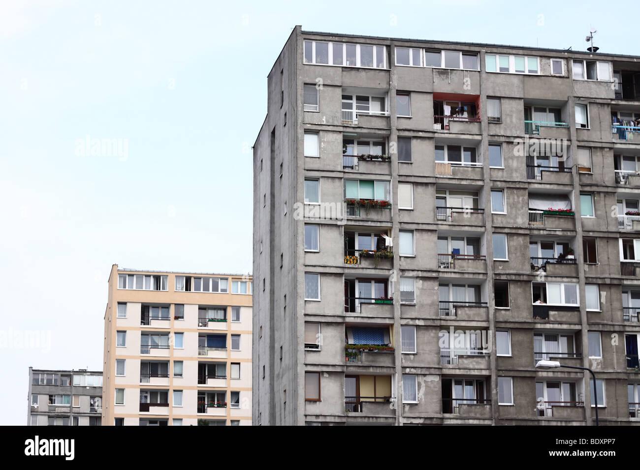 Warsaw Poland old style communist era public housing concrete flats note renovated bloc behind taken Summer 2009 - Stock Image