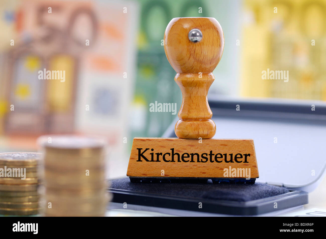 Stamp labelled 'Kirchensteuer', German for 'church tax' - Stock Image