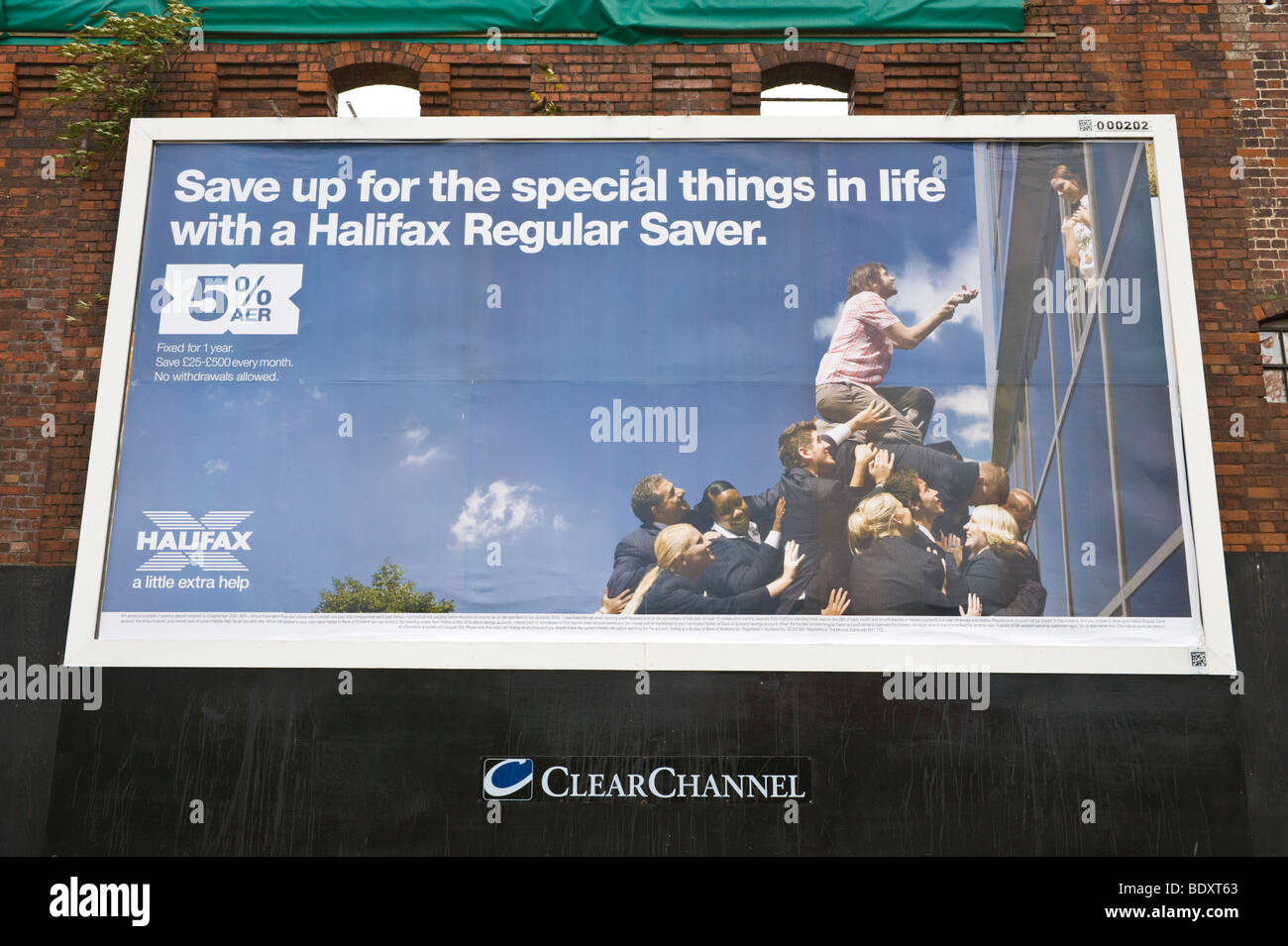 ClearChannel billboard for Halifax Regular Saver on side of derelict building in UK - Stock Image