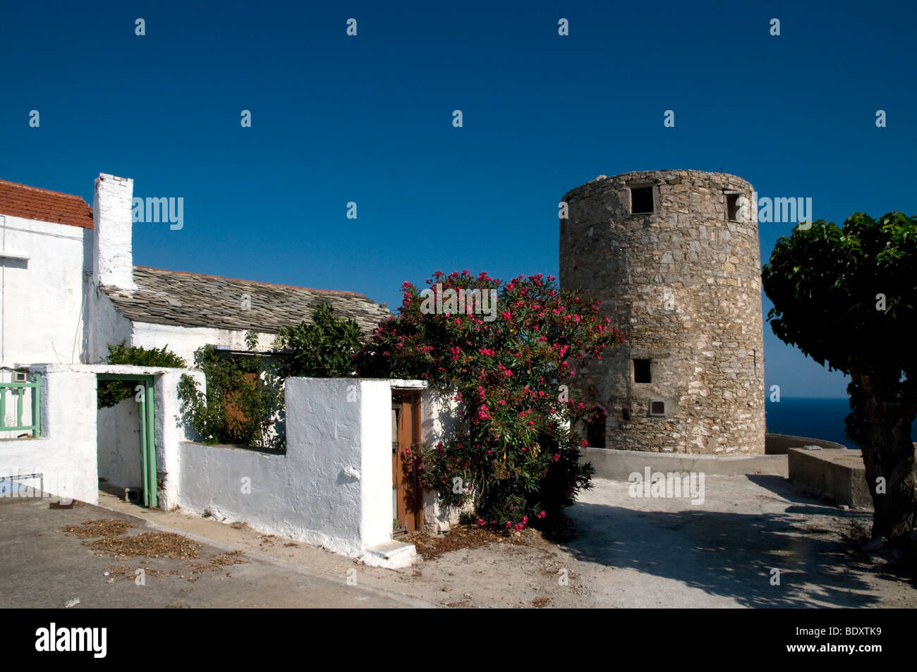 Old Town Alonissos. hora , old  town  scene with disused windmill now  converted to a home, Greek Islands - Stock Image