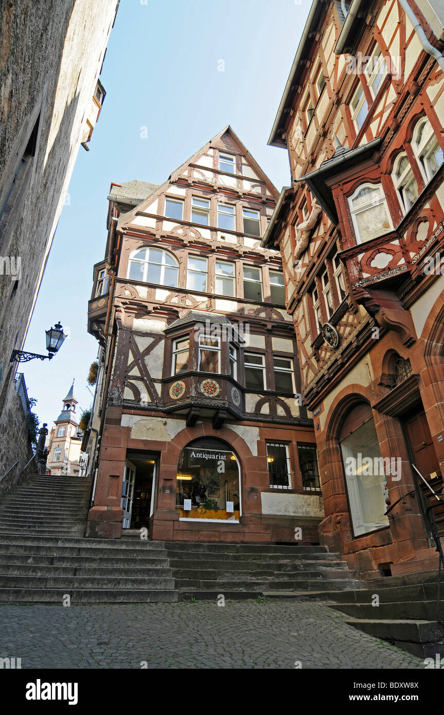 Second hand bookshop, shop for antique books, Steile Strasse street, stairs, historic half-timbered houses, historic Stock Photo