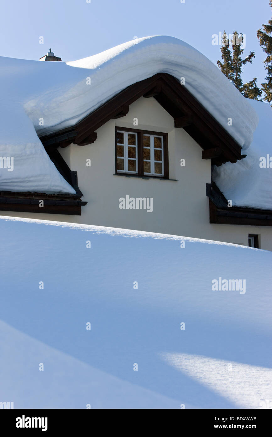 Deep winter snow on a rooftop in St. Moritz, Upper Engadine, Oberengadin, Graubunden region, Swiss Alps, Switzerland, - Stock Image
