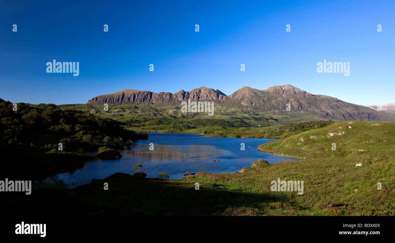 Quinag mountain range with a lake in the Scottish Highlands, Scotland, UK, Europe Stock Photo
