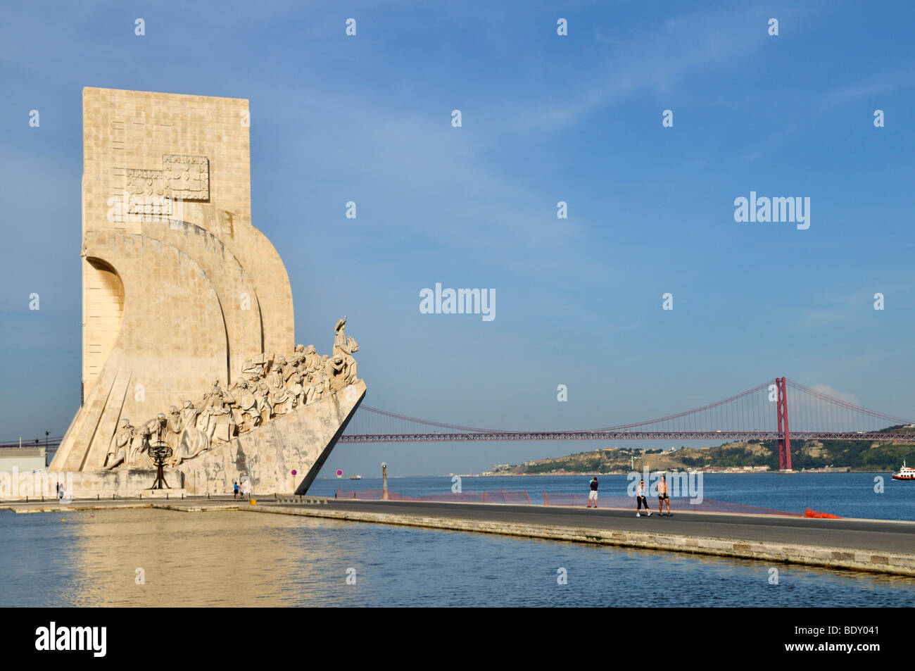 Monument to the Discoveries, Padrao dos Descobrimentos, on the estuary of the Tagus river, bridge Ponte 25 de Abril - Stock Image