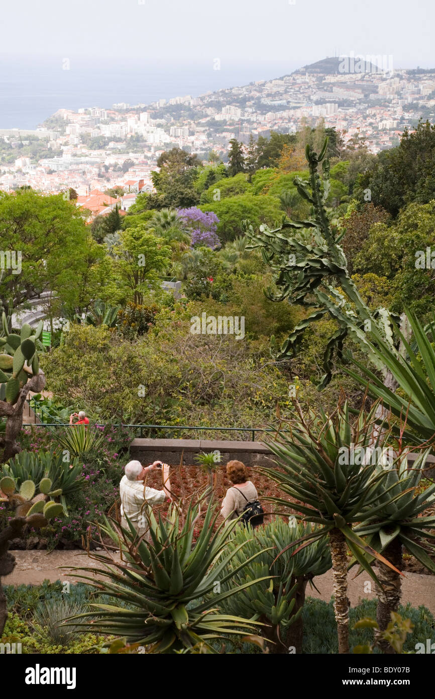 An elderly couple view the botanical gardens of Funchal in Madeira ...