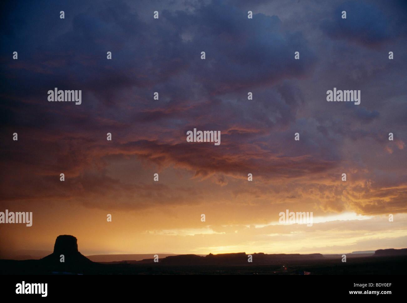 Sunset with menacing storm clouds over Monument Valley, Kayenta, Arizona, USA - Stock Image