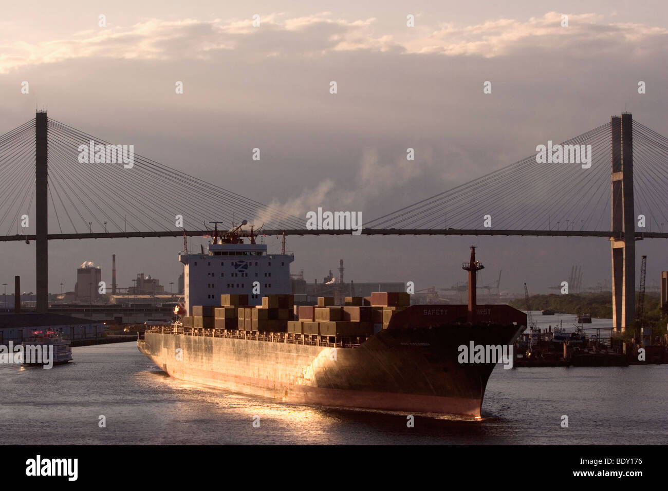 The MSC Colombia container ship navigates under the Talmadge Memorial Bridge on the Savannah River - Stock Image