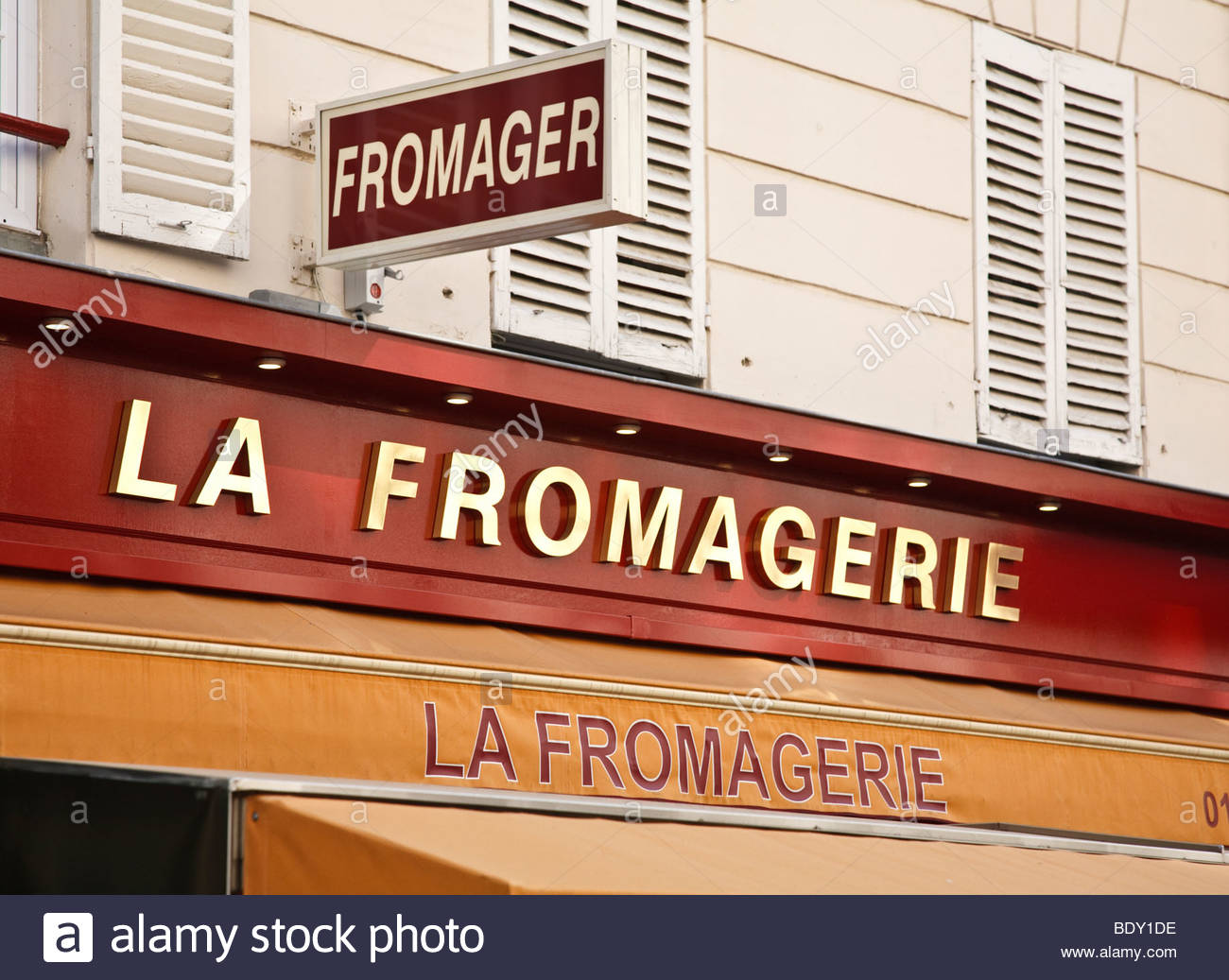 Shop signs above a Fromagerie (cheese shop) on Rue Cler in Paris, France - Stock Image