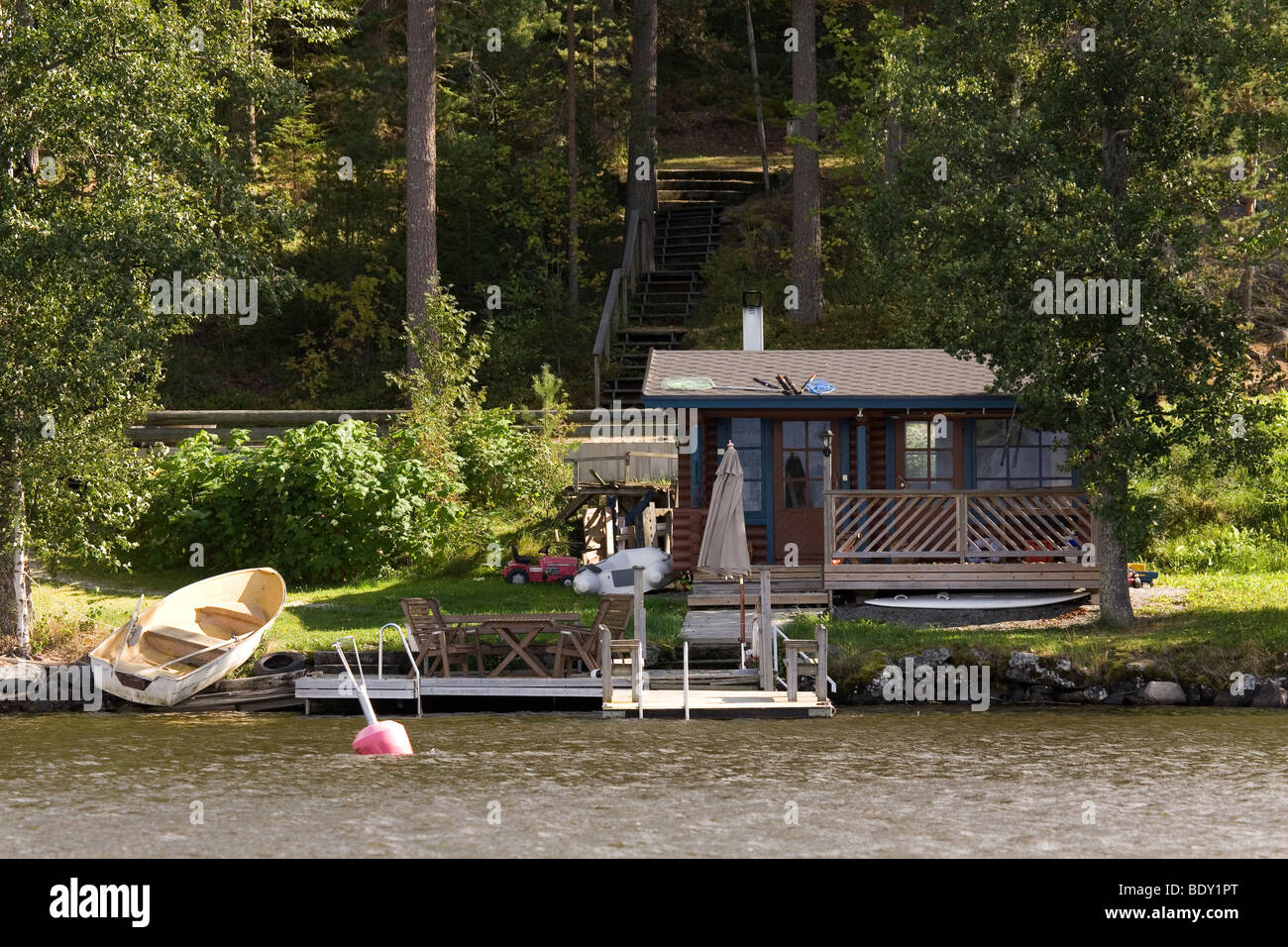 A traditional Finnish Summer Cottage by the banks of Lake Rautavasi, close to the Finnish town of Vammala in the - Stock Image