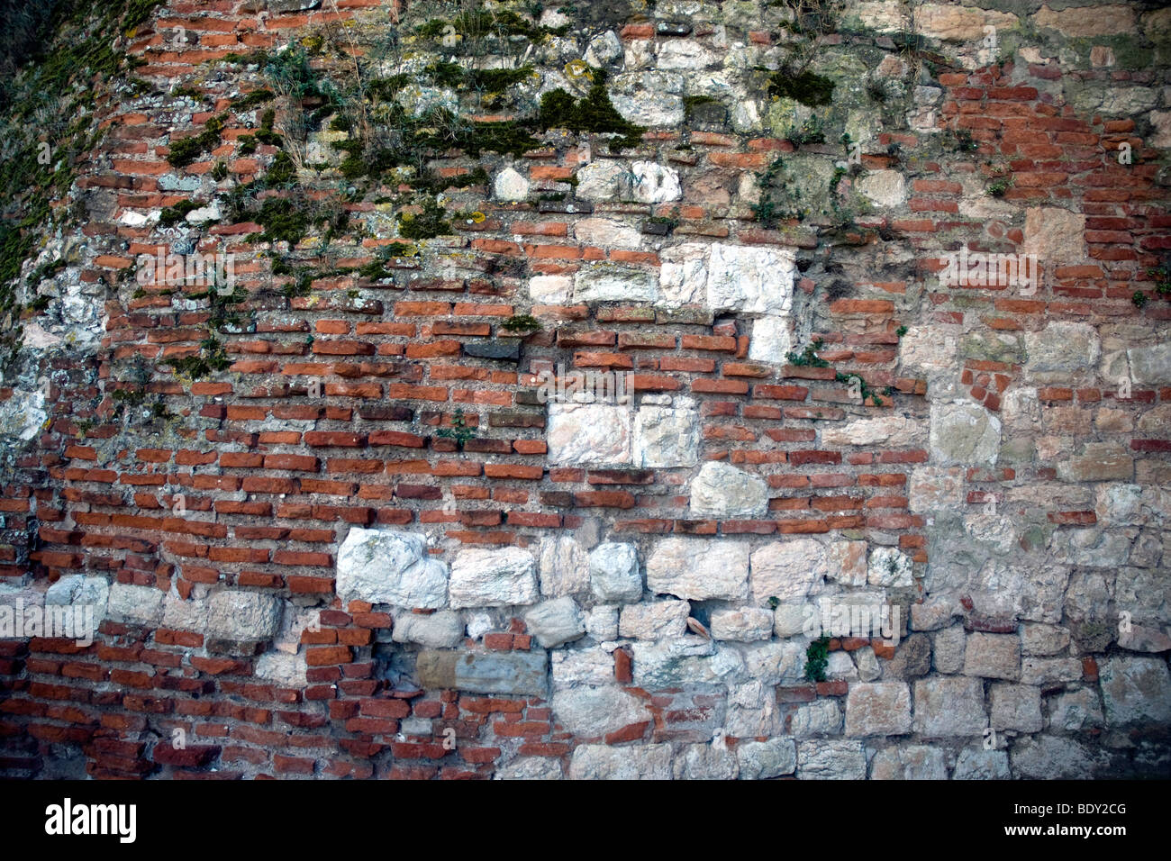 A wall of red bricks and stone is emblematic of Albi's gloriously mixed building materials - Stock Image