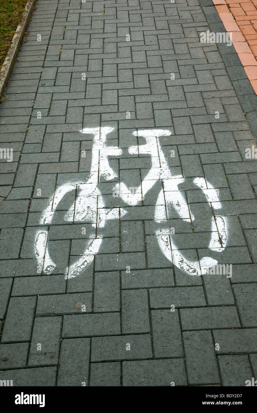 photograph of bicycle image painted on cycle way - Stock Image