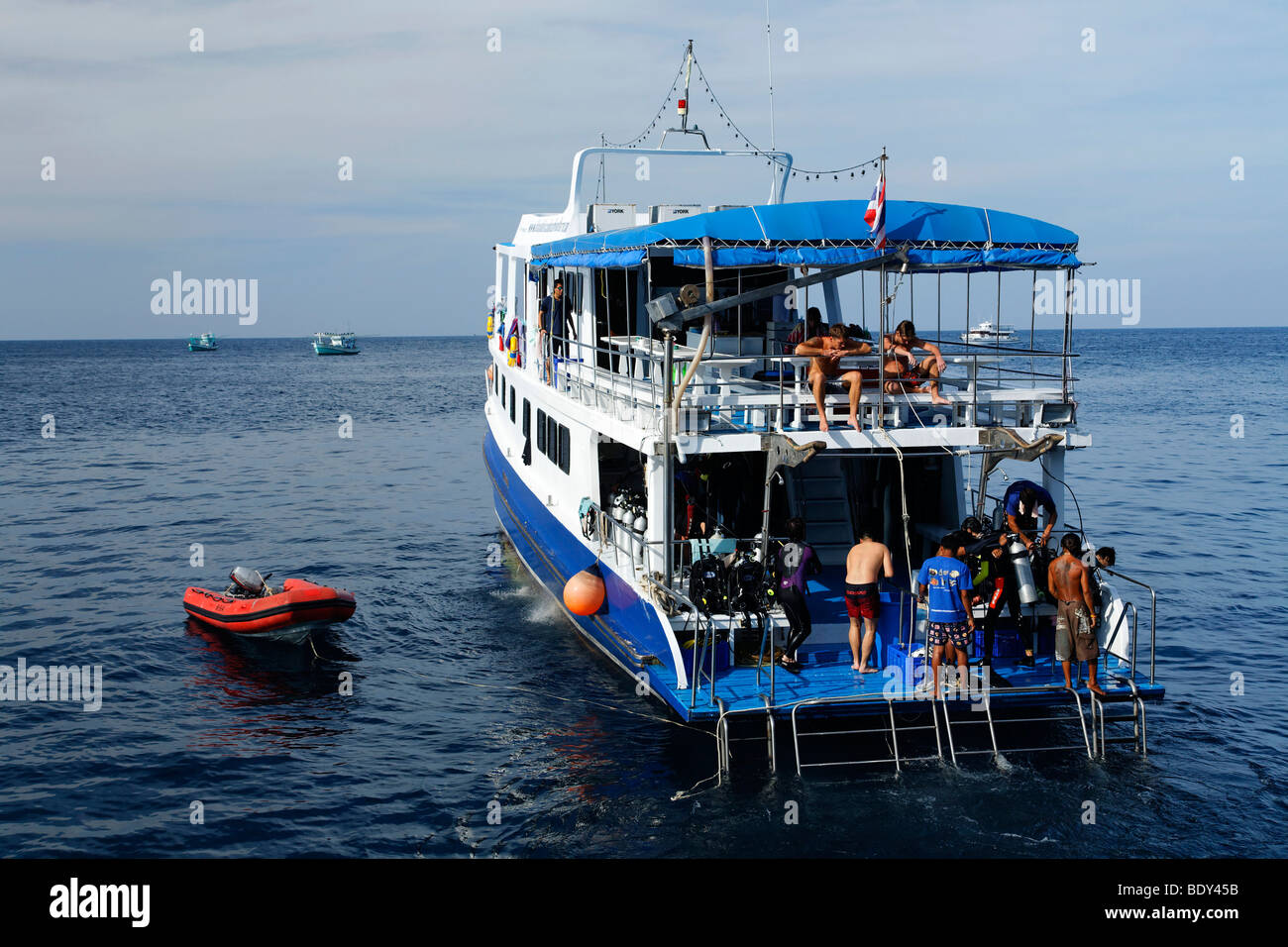 Dive ship picking up group of divers from the sea, Similan Islands, Phuket, Thailand, Asia, Andaman Sea, Indian - Stock Image