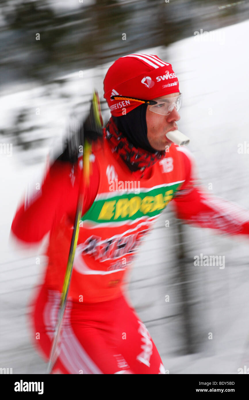 Biathletes during Training Men, with air warmer in the mouth to protect his bronchial tubes against the cold, Biathlon - Stock Image